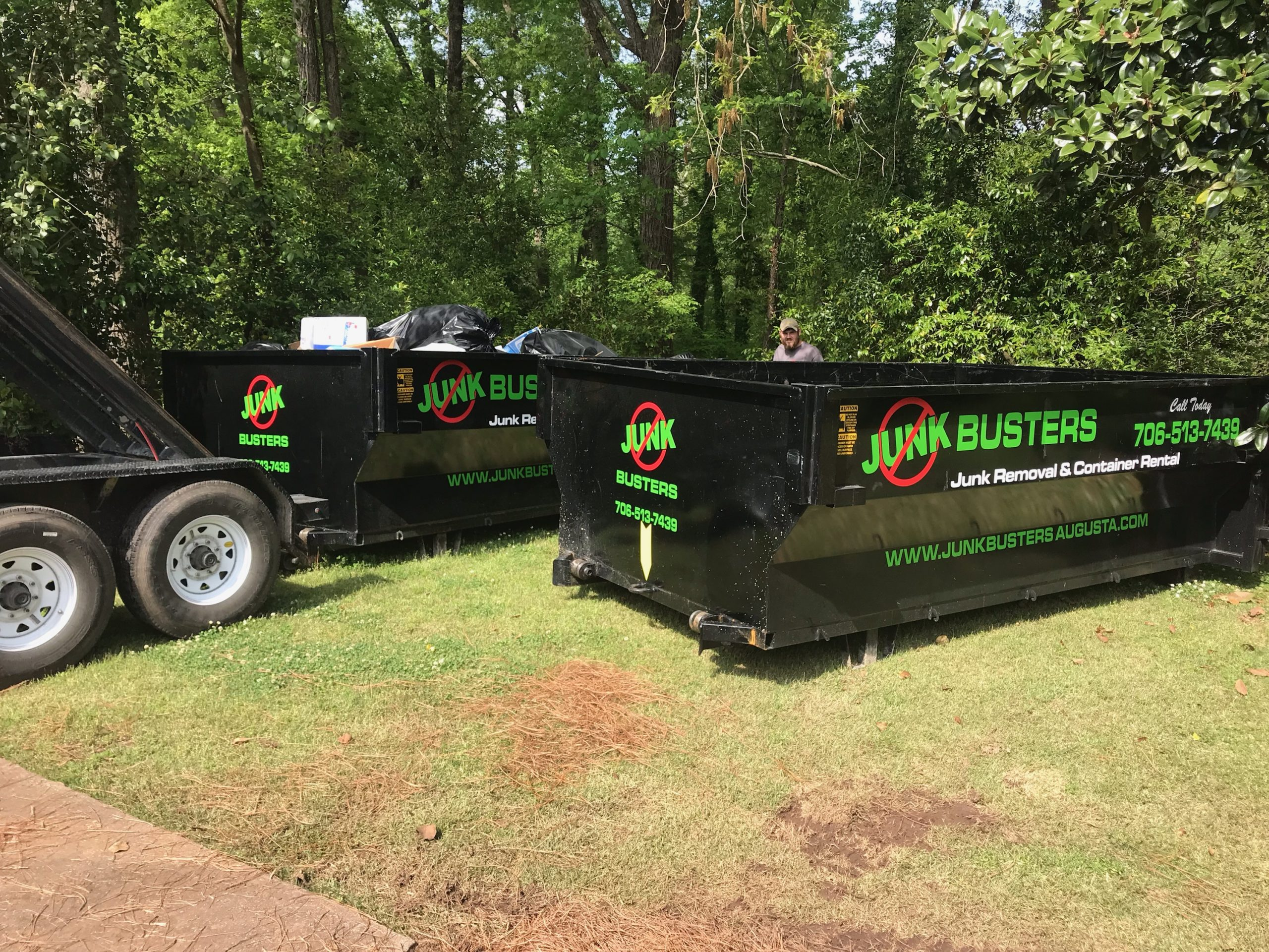 junk removal service loading dumpsters